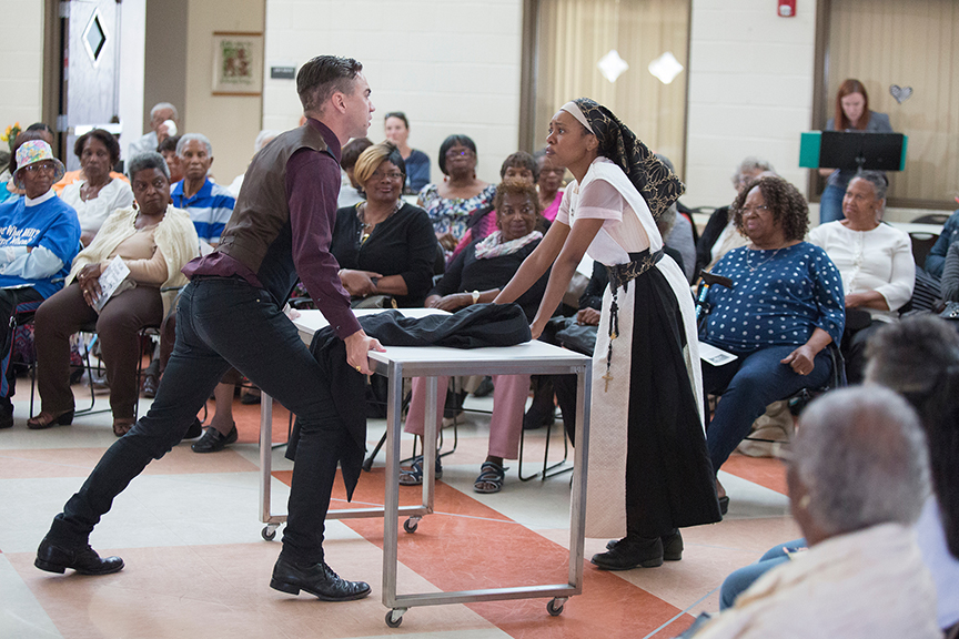 (from left) Daniel Petzold as Angelo and Makha Mthembu as Isabella performing for the audience from Fourth District Senior Center at George Stevens Senior Center. The 2016 production of The Old Globe's touring program Globe for All, Shakespeare's Measure for Measure, directed by Patricia McGregor, tours community venues Nov. 1 - 20. Photo by Jim Cox.