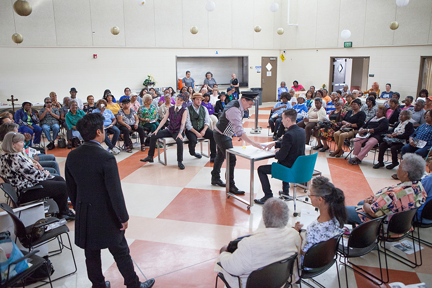 (from left) Flordelino Lagundino as Escalus, Ally Carey as Pompey, Jake Millgard as Froth, Christopher Salazar as Elbow, and Daniel Petzold as Angelo performing for the audience from Fourth District Senior Resource Center at George Stevens Senior Center. The 2016 production of The Old Globe's touring program Globe for All, Shakespeare's Measure for Measure, directed by Patricia McGregor, tours community venues Nov. 1 - 20. Photo by Jim Cox.