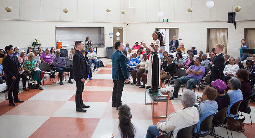 (from left) Flordelino Lagundino as Escalus, Daniel Petzold as Angelo, Christopher Salazar as Duke, Mahka Mthembu as Isabella, and Ally Carey as Provost performing for the audience from Fourth District Senior Resource Center at George Stevens Senior Center. The 2016 production of The Old Globe's touring program Globe for All, Shakespeare's Measure for Measure, directed by Patricia McGregor, tours community venues Nov. 1 - 20. Photo by Jim Cox.