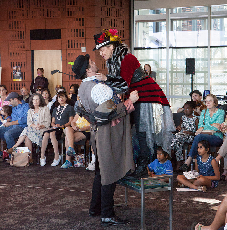 (from left) Jake Millgard as Lucio and Lisel Gorell-Getz as Mistress Overdone performing for the audience from the San Diego Public Library, Central Branch. The 2016 production of The Old Globe's touring program Globe for All, Shakespeare's Measure for Measure, directed by Patricia McGregor, tours community venues Nov. 1 - 20. Photo by Jim Cox.