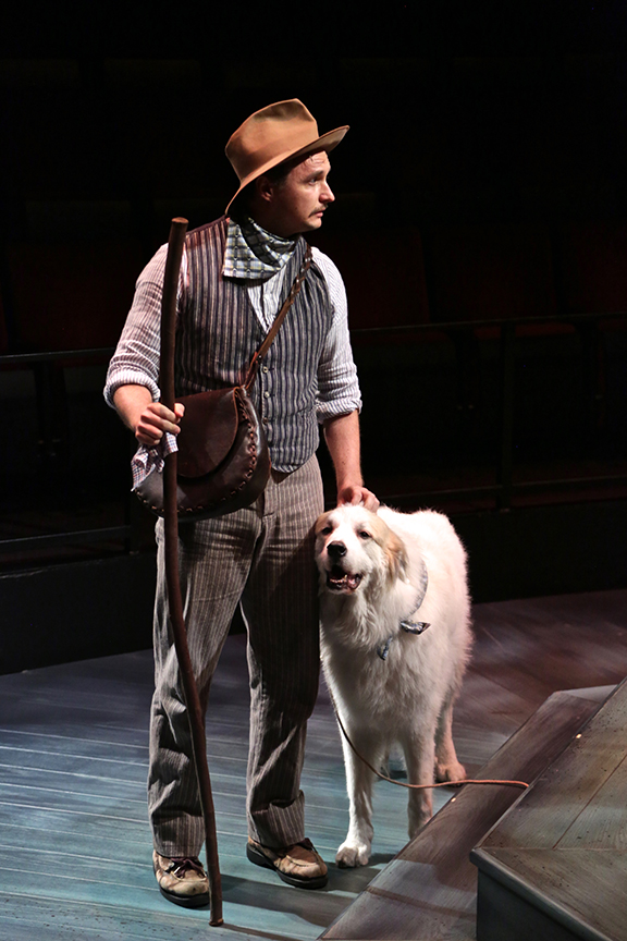 Lorenzo Landini as Launce and Samson as Crab the Dog in The Old Globe and University of San Diego Shiley Graduate Theatre Program production of William Shakespeare's The Two Gentlemen of Verona, directed by Richard Seer, November 12 - 20, 2016. Photo by Adriana Zuniga Photography.