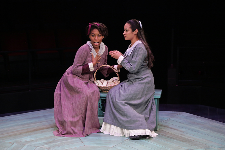 (from left) Christina A. Okolo as Lucetta and Suzelle Palacios as Julia in The Old Globe and University of San Diego Shiley Graduate Theatre Program production of William Shakespeare's The Two Gentlemen of Verona, directed by Richard Seer, November 12 - 20, 2016. Photo by Adriana Zuniga Photography.