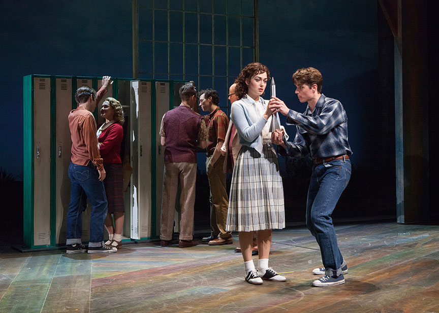 (foreground) Eliza Palasz as Dorothy and Kyle Selig as Homer Hickam with the cast of the West Coast premiere of October Sky, with book by Brian Hill and Aaron Thielen, music and lyrics by Michael Mahler, directed and choreographed by Rachel Rockwell, inspired by the Universal Pictures film and Rocket Boys by Homer H. Hickam, Jr., running Sept. 10 - Oct. 23, 2016 at The Old Globe. Photo by Jim Cox.