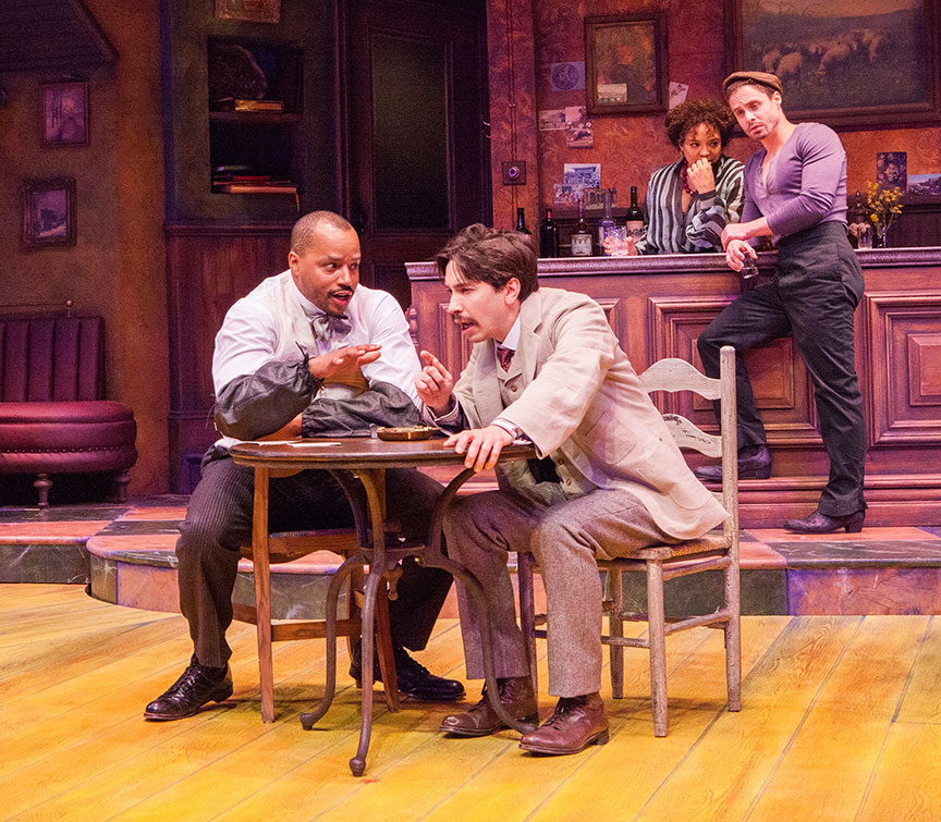 (from left) Donald Faison as Freddy, Justin Long as Albert Einstein, Luna Veléz as Germaine, and Philippe Bowgen as Pablo Picasso in Picasso at the Lapin Agile, by Steve Martin, directed by Barry Edelstein, running February 4 - March 12, 2017 at The Old Globe. Photo by Jim Cox.