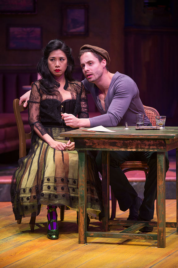 Liza Lapira as Suzanne and Philippe Bowgen as Pablo Picasso in Picasso at the Lapin Agile, by Steve Martin, directed by Barry Edelstein, running February 4 - March 12, 2017 at The Old Globe. Photo by Jim Cox.
