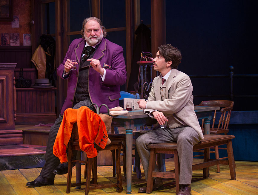 (from left) Ron Orbach as Sagot and Justin Long as Albert Einstein in Picasso at the Lapin Agile, by Steve Martin, directed by Barry Edelstein, running February 4 - March 12, 2017 at The Old Globe. Photo by Jim Cox.