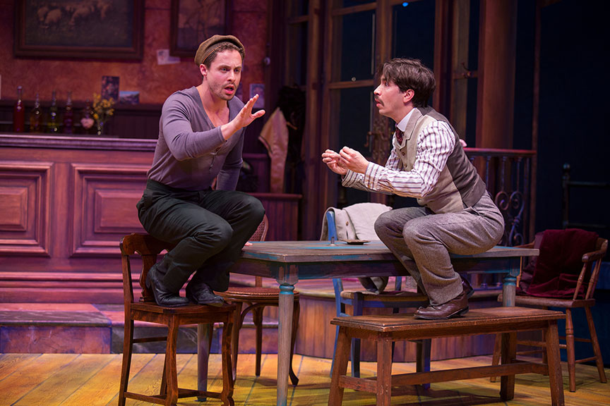 (from left) Philippe Bowgen as Pablo Picasso and Justin Long as Albert Einstein in Picasso at the Lapin Agile, by Steve Martin, directed by Barry Edelstein, running February 4 - March 12, 2017 at The Old Globe. Photo by Jim Cox.