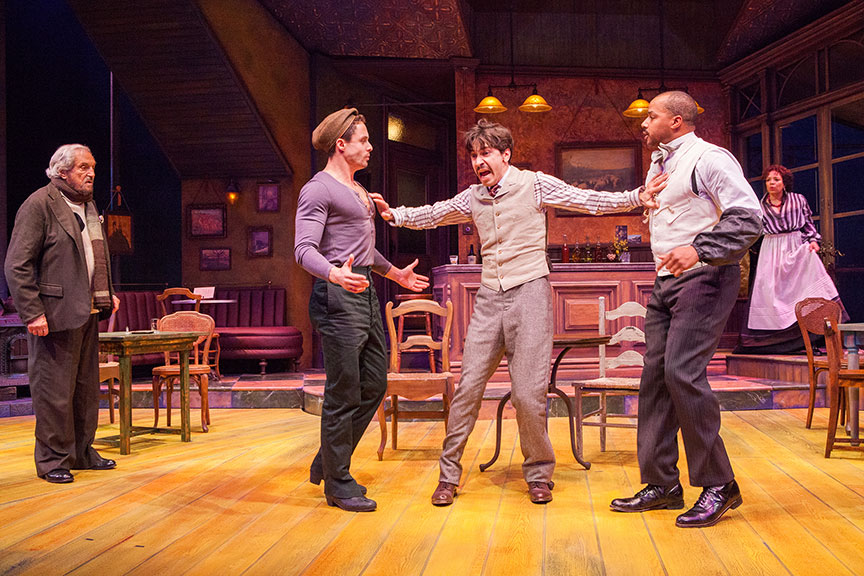 (from left) Hal Linden as Gaston, Philippe Bowgen as Pablo Picasso, Justin Long as Albert Einstein, Donald Faison as Freddy, and Luna Veléz as Germaine in Picasso at the Lapin Agile, by Steve Martin, directed by Barry Edelstein, running February 4 - March 12, 2017 at The Old Globe. Photo by Jim Cox.