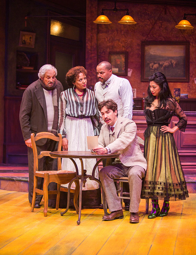 (from left) Hal Linden as Gaston, Luna Veléz as Germaine, Donald Faison as Freddy, Justin Long as Albert Einstein, and Liza Lapira as Suzanne in Picasso at the Lapin Agile, by Steve Martin, directed by Barry Edelstein, running February 4 - March 12, 2017 at The Old Globe. Photo by Jim Cox.