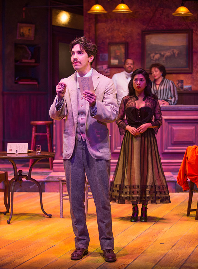 (from left) Justin Long as Albert Einstein, Donald Faison as Freddy, Liza Lapira as Suzanne, and Luna Veléz as Germaine in Picasso at the Lapin Agile, by Steve Martin, directed by Barry Edelstein, running February 4 - March 12, 2017 at The Old Globe. Photo by Jim Cox.
