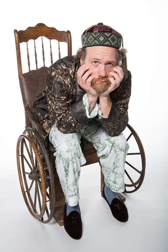 Andy Grotelueschen appears as Argan in the world premiere adaptation of Molière's The Imaginary Invalid, adapted by Fiasco Theater, running May 27 – July 2, 2017 at The Old Globe. Photo by Jim Cox.