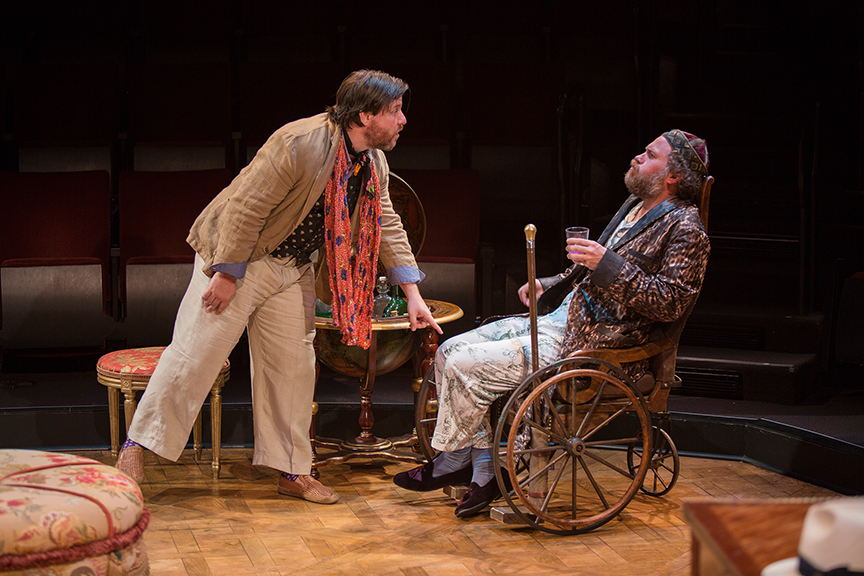 (from left) Paul L. Coffey appears as Béralde and Andy Grotelueschen appears as Argan in the world premiere adaptation of Molière's The Imaginary Invalid, adapted by Fiasco Theater, running May 27 – June 25, 2017 at The Old Globe. Photo by Jim Cox.