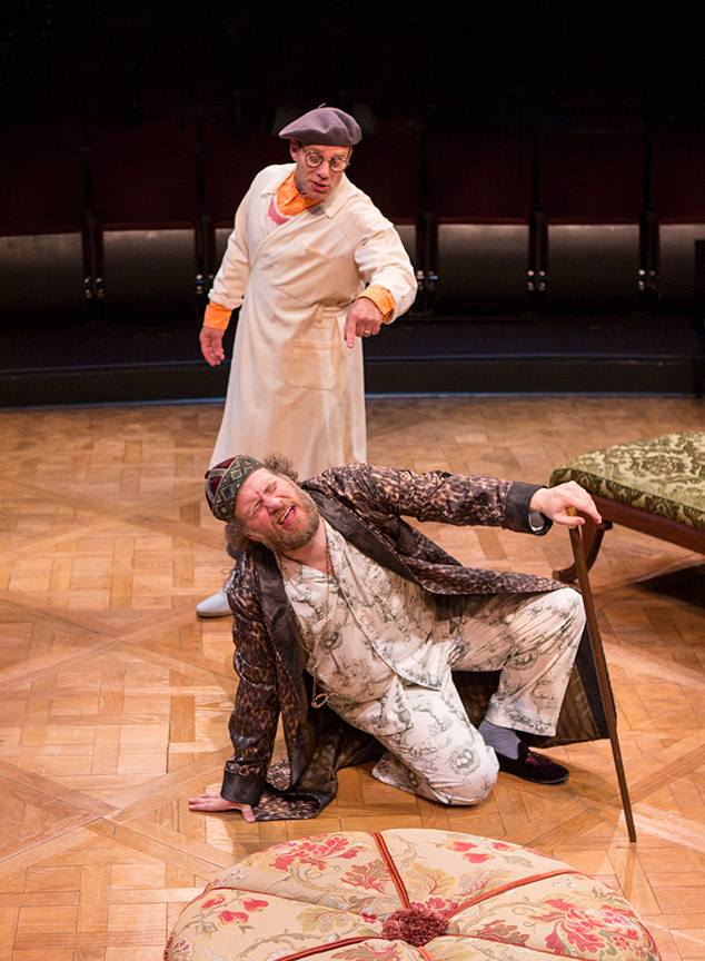 (from left) Noah Brody appears as Dr. Purgon and Andy Grotelueschen as Argan in the world premiere adaptation of Molière's The Imaginary Invalid, adapted by Fiasco Theater, running May 27 – June 25, 2017 at The Old Globe. Photo by Jim Cox.
