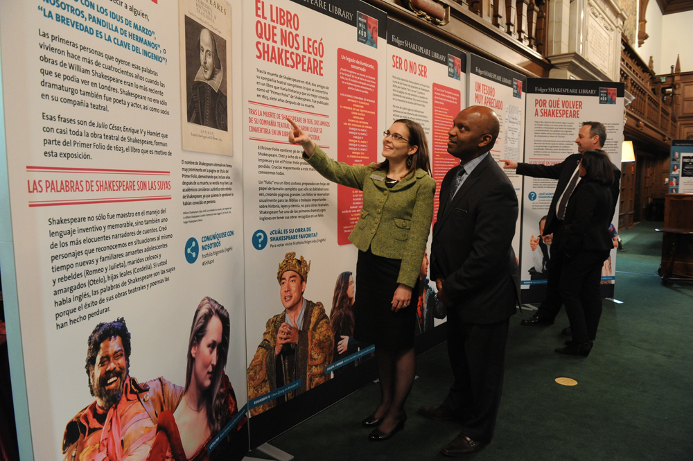 Guests take in the First Folio display at the Folger Shakespeare Library in Washington, D.C.  Photo by Lloyd Wolf.
