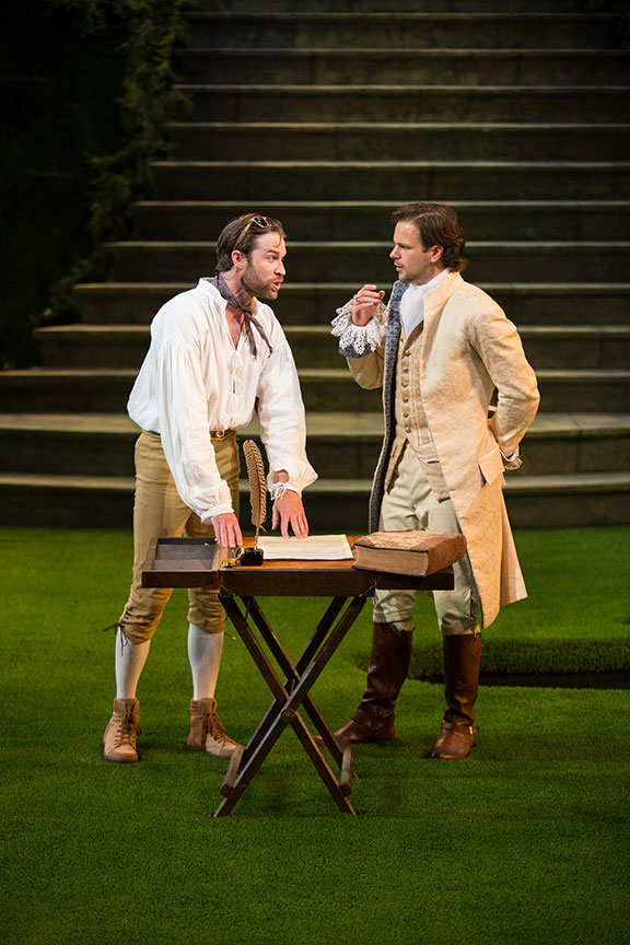 (from left) Kieran Campion as Berowne and Jonny Orsini as Ferdinand, King of Navarre in William Shakespeare's Love's Labor's Lost, directed by Kathleen Marshall, running August 14 - September 18, 2016 at The Old Globe. Photo by Jim Cox.