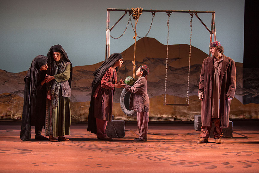(from left) Denmo Ibrahim as Mariam, Nadine Malouf as Laila, Nikita Tewani as Aziza, Arden Pala as Zalmai, and Haysam Kadri as Rasheed in A Thousand Splendid Suns, written by Ursula Rani Sarma, based on the book by Khaled Hosseini, directed by Carey Perloff, and co-produced by American Conservatory Theater, runs May 12 – June 17, 2018 at The Old Globe. Photo by Jim Cox.