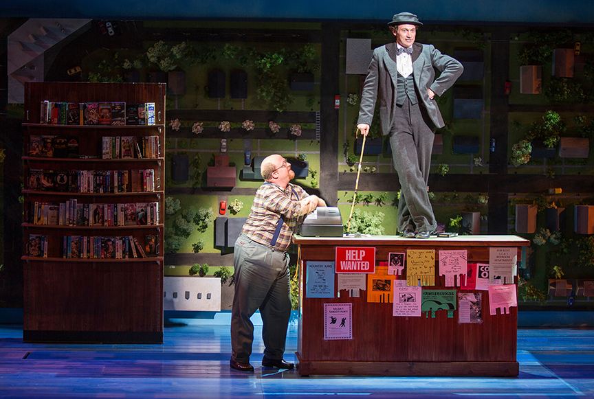 (from left) Jason SweetTooth Williams as Video Store Owner and Bryce Pinkham as Sam  in Benny & Joon, book by Kirsten Guenther, music by Nolan Gasser, lyrics by Mindi Dickstein, directed by Jack Cummings III, running September 7 – October 22, 2017 at The Old Globe. Photo by Jim Cox.