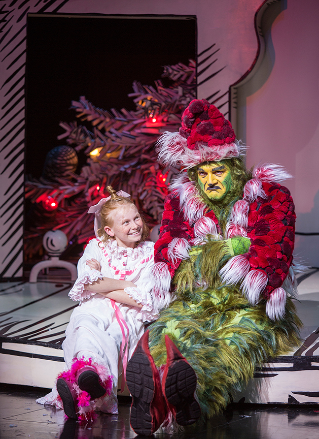 Reese McCulloch appears as Cindy-Lou Who and Edward Watts as The Grinch in Dr. Seuss's How the Grinch Stole Christmas!, book and lyrics by Timothy Mason, music by Mel Marvin, original production conceived and directed by Jack O'Brien, original choreography by John DeLuca, and directed by James Vásquez, running November 4 – December 24, 2017 at The Old Globe. Photo by Jim Cox.