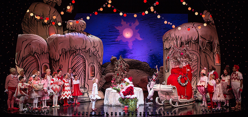 Reese McCulloch (center) with the cast of Dr. Seuss's How the Grinch Stole Christmas!, book and lyrics by Timothy Mason, music by Mel Marvin, original production conceived and directed by Jack O'Brien, original choreography by John DeLuca, and directed by James Vásquez, running November 4 – December 24, 2017 at The Old Globe. Photo by Jim Cox.