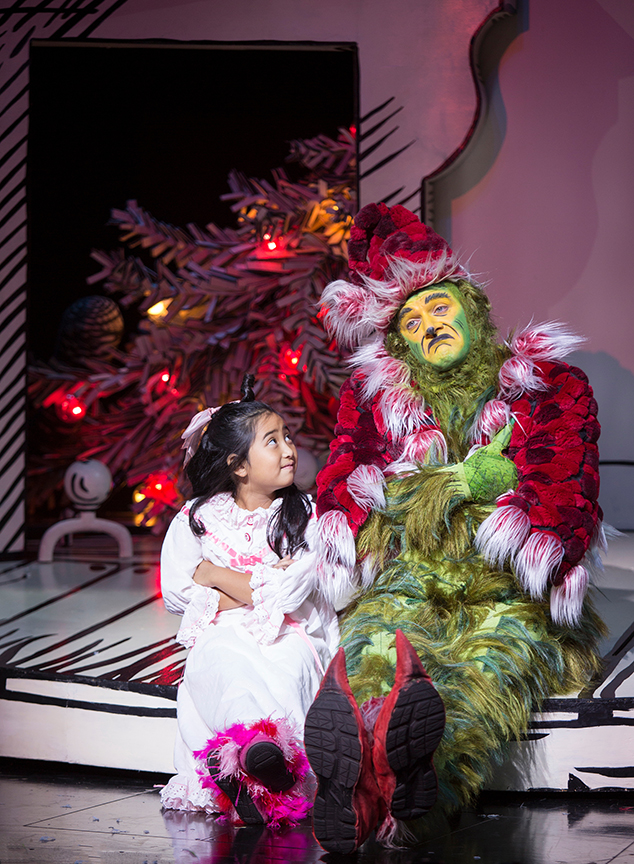 Abigail Estrella appears as Cindy-Lou Who and Edward Watts as The Grinch in Dr. Seuss's How the Grinch Stole Christmas!, book and lyrics by Timothy Mason, music by Mel Marvin, original production conceived and directed by Jack O'Brien, original choreography by John DeLuca, and directed by James Vásquez, running November 4 – December 24, 2017 at The Old Globe. Photo by Jim Cox.