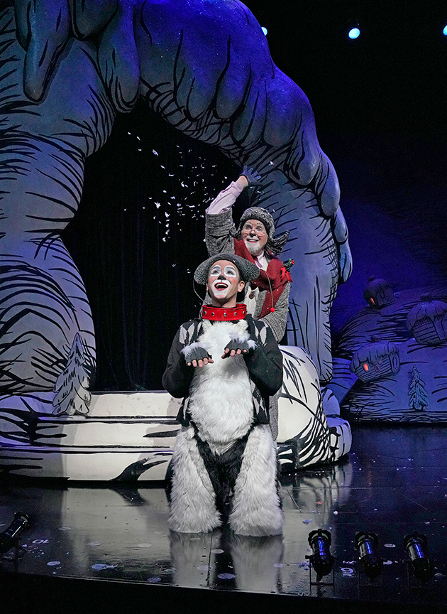 (front) Tommy Martinez appears as Young Max and Steve Gunderson as Old Max in Dr. Seuss's How the Grinch Stole Christmas!, book and lyrics by Timothy Mason, music by Mel Marvin, original production conceived and directed by Jack O'Brien, original choreography by John DeLuca, and directed by James Vásquez, running November 3 – December 29, 2018 at The Old Globe. Photo by Ken Howard.