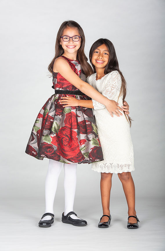 Sadie Tess Coleman and Leila Manuel appear as Cindy-Lou Who in Dr. Seuss's How the Grinch Stole Christmas!, book and lyrics by Timothy Mason, music by Mel Marvin, original production conceived and directed by Jack O'Brien, original choreography by John DeLuca, and directed by James Vásquez, runs November 3 – December 29, 2018 at The Old Globe. Photo by Jim Cox.