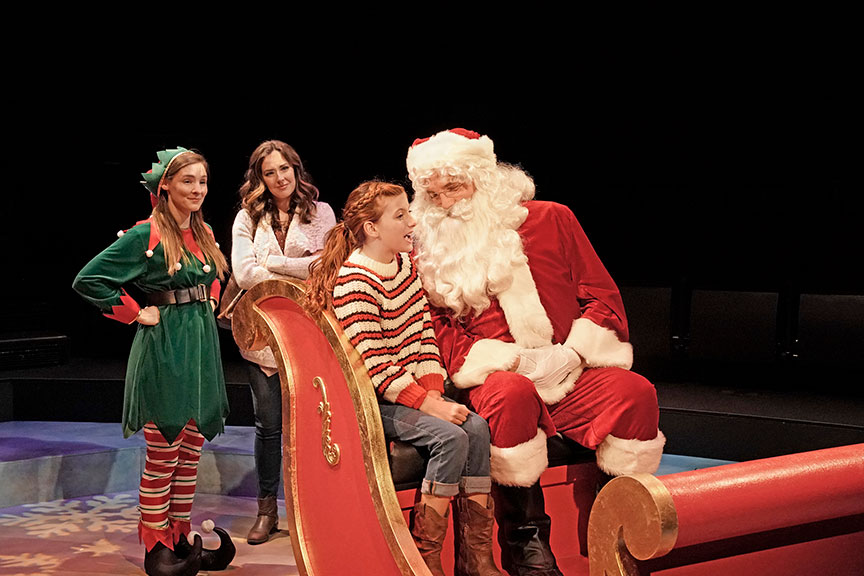 (from left) Katie Sapper as Ensemble, Liana Hunt as Jessie Randolf, Kaylin Hedges as Ellie Randolf, and Bryant Martin as Santa in Clint Black's Looking for Christmas, running November 11 – December 31, 2018 at The Old Globe. Photo by Ken Howard.