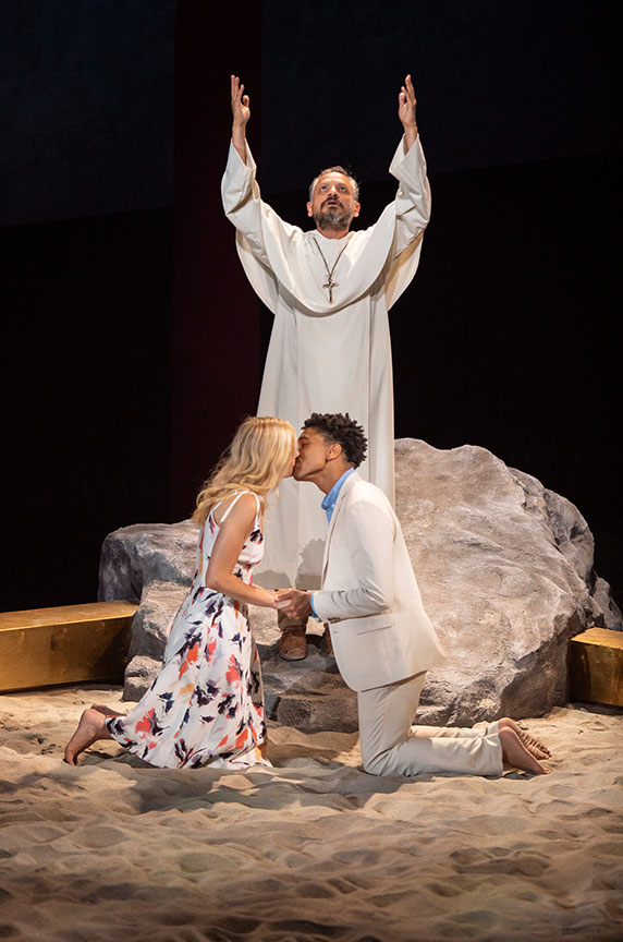 Jesse J. Perez as Friar Lawrence, with Louisa Jacobson as Juliet, and Aaron Clifton Moten as Romeo. Romeo and Juliet, by William Shakespeare and directed by Barry Edelstein, runs August 11 – September 15, 2019 at The Old Globe. Photo by Jim Cox.