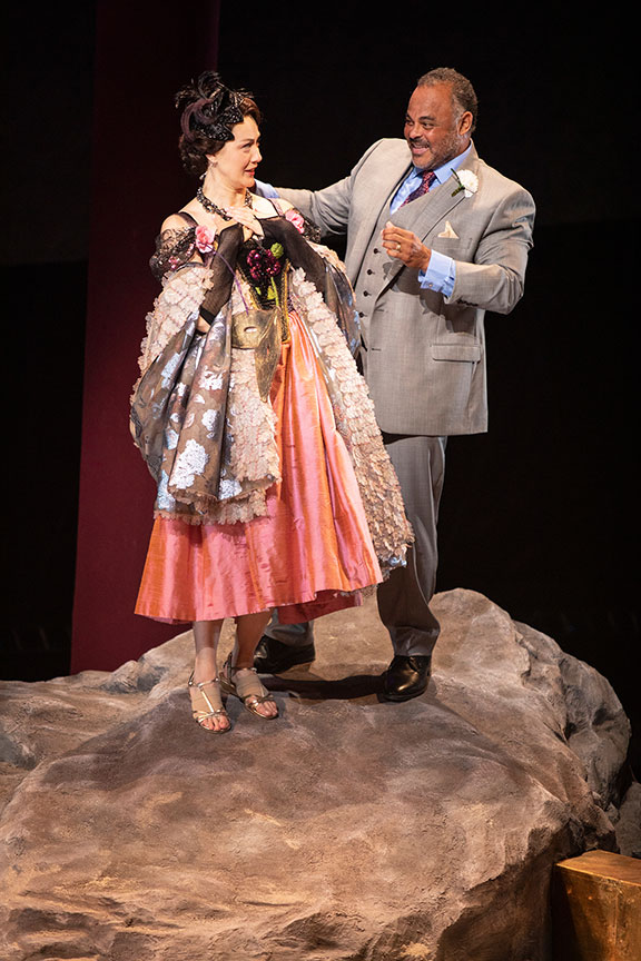 Sofia Jean Gomez as Lady Capulet and Cornell Womack as Lord Capulet. Romeo and Juliet, by William Shakespeare and directed by Barry Edelstein, runs August 11 – September 15, 2019 at The Old Globe. Photo by Jim Cox.