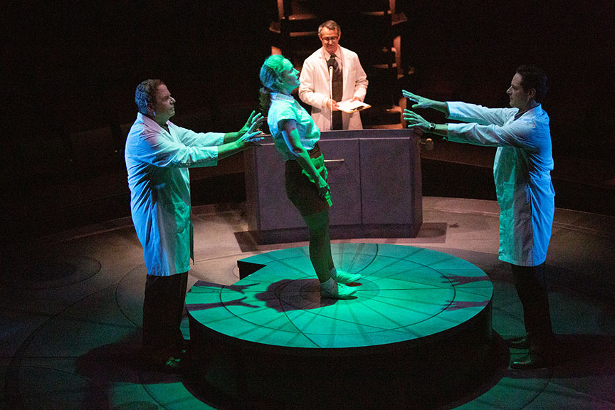 Michael Pemberton as Lab Tech, Morgan Hallett as Jerrie Cobb, Matthew Boston as Dr. Randy Lovelace, and Peter Rini as Lab Tech in They Promised Her the Moon, running April 6 – May 12, 2019 at The Old Globe. Photo by Jim Cox.