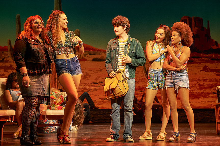 (from left) Katie Ladner as Sapphire, Solea Pfeiffer as Penny Lane, Casey Likes as William Miller, Julia Cassandra as Estrella, and Storm Lever as Polexia. Almost Famous, a world-premiere musical with book and lyrics by Cameron Crowe, based on the Paramount Pictures and Columbia Pictures motion picture written by Cameron Crowe, directed by Jeremy Herrin, with original music and lyrics by Tom Kitt, runs September 13 – October 27, 2019 at The Old Globe. Photo by Neal Preston.