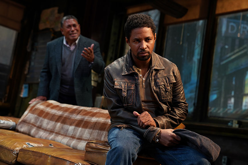 Steven Anthony Jones as Becker (background) and Amari Cheatom as Youngblood in August Wilson's Jitney, directed by Ruben Santiago-Hudson, runs January 18 – February 23, 2020 at The Old Globe. Photo by Joan Marcus.