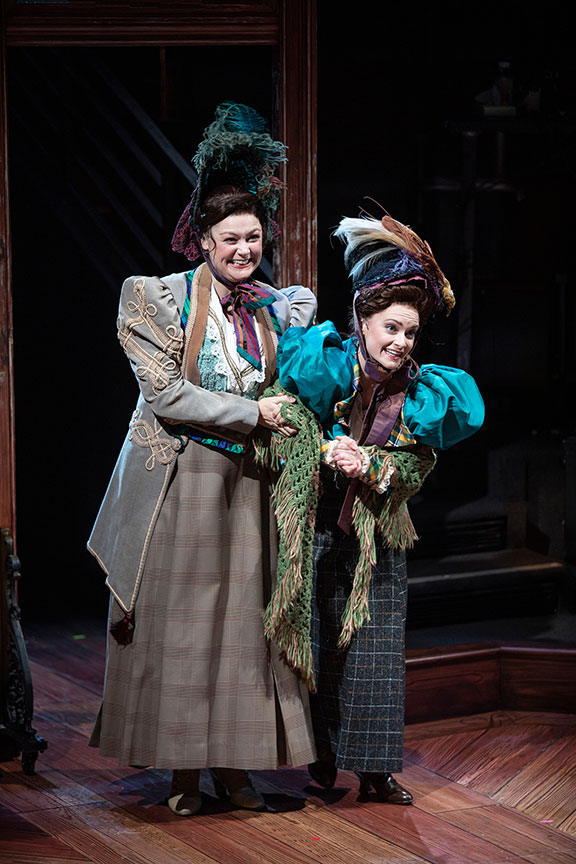 Jacque Wilke as Gertrude Saint and Cathryn Wake as Prudence Saint. Ebenezer Scrooge's BIG San Diego Christmas Show runs November 23 – December 29, 2019 at The Old Globe. Photo by Jim Cox.