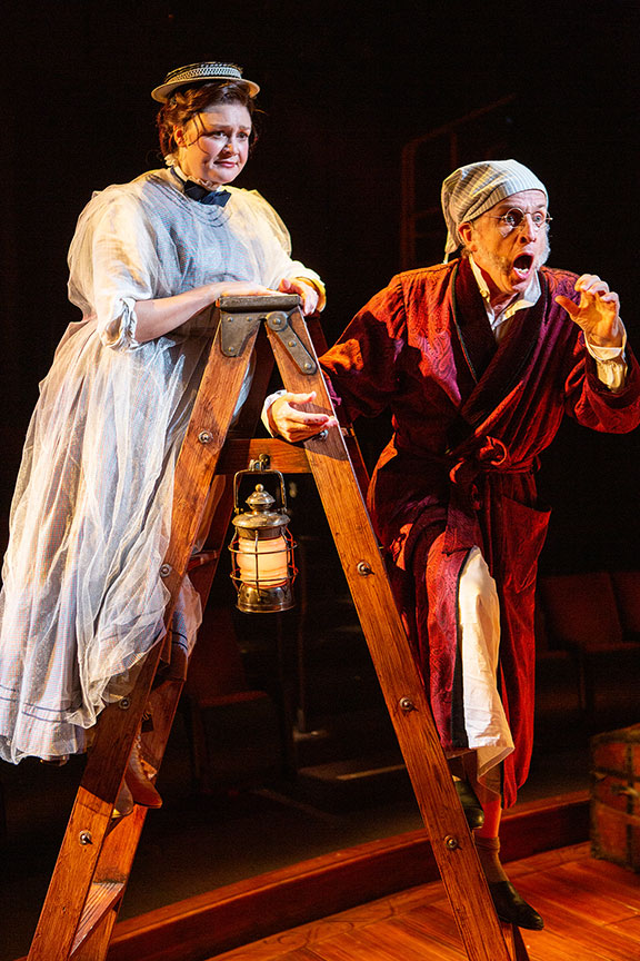 Jacque Wilke as Ghost of Christmas Past and Robert Joy as Ebenezer Scrooge. Ebenezer Scrooge's BIG San Diego Christmas Show runs November 23 – December 29, 2019 at The Old Globe. Photo by Jim Cox.