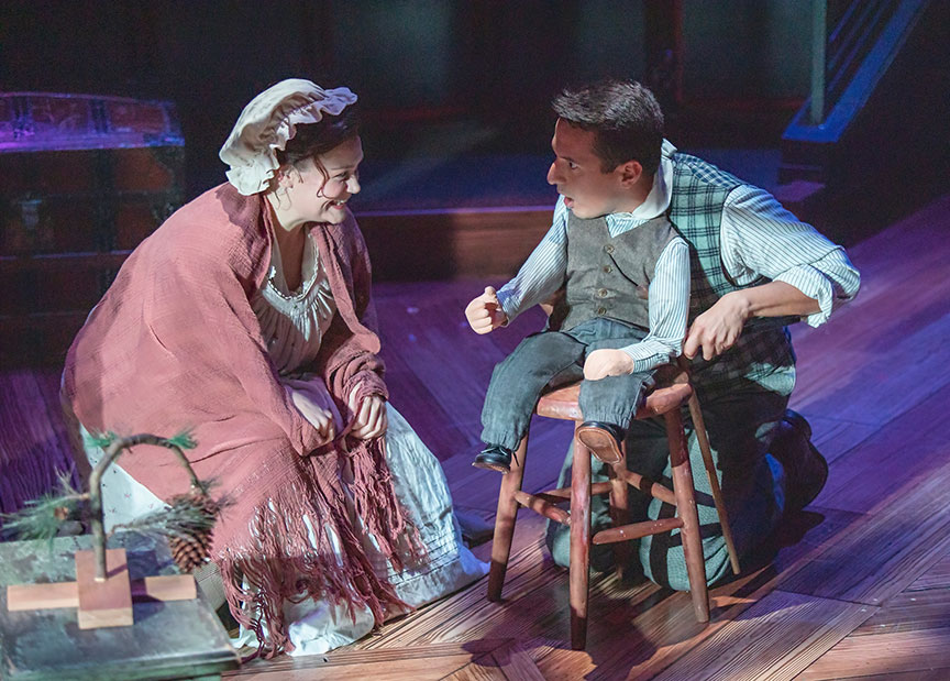 Jacque Wilke as Mrs. Cratchit and Dan Rosales as Tiny Tim. Ebenezer Scrooge's BIG San Diego Christmas Show runs November 23 – December 29, 2019 at The Old Globe. Photo by Jim Cox.