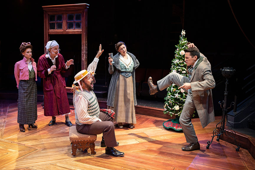 Cathryn Wake as Ghost of Christmas Present, Robert Joy as Ebenezer Scrooge, Orville Mendoza as Jack, Jacque Wilke as Jennie, and Dan Rosales as Fred. Ebenezer Scrooge's BIG San Diego Christmas Show runs November 23 – December 29, 2019 at The Old Globe. Photo by Jim Cox.