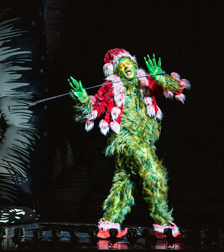 Edward Watts as The Grinch in Dr. Seuss's How the Grinch Stole Christmas!, book and lyrics by Timothy Mason, music by Mel Marvin, original production conceived and directed by Jack O'Brien, original choreography by John DeLuca, and directed by James Vásquez, running November 10 – December 29, 2019 at The Old Globe. Photo by Jim Cox.