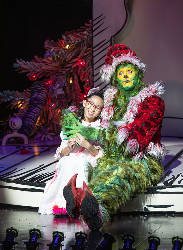 Sophia Adajar as Cindy-Lou Who and Edward Watts as The Grinch. Dr. Seuss's How the Grinch Stole Christmas!, book and lyrics by Timothy Mason, music by Mel Marvin, original production conceived and directed by Jack O'Brien, original choreography by John DeLuca, and directed by James Vásquez, running November 10 – December 29, 2019 at The Old Globe. Photo by Jim Cox.