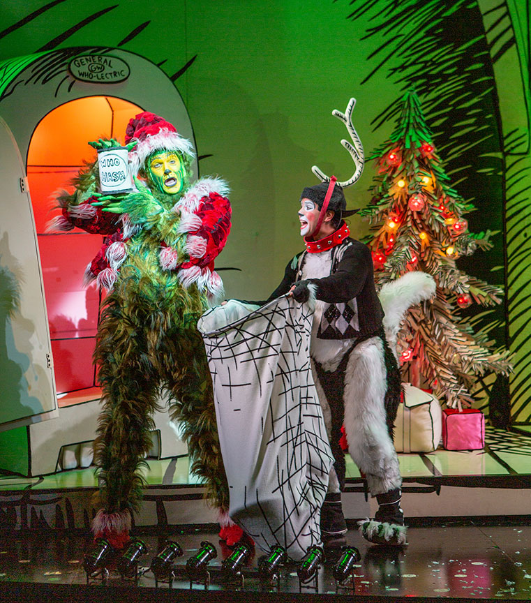 Edward Watts as The Grinch and Tommy Martinez as Young Max. Dr. Seuss's How the Grinch Stole Christmas!, book and lyrics by Timothy Mason, music by Mel Marvin, original production conceived and directed by Jack O'Brien, original choreography by John DeLuca, and directed by James Vásquez, running November 10 – December 29, 2019 at The Old Globe. Photo by Jim Cox.