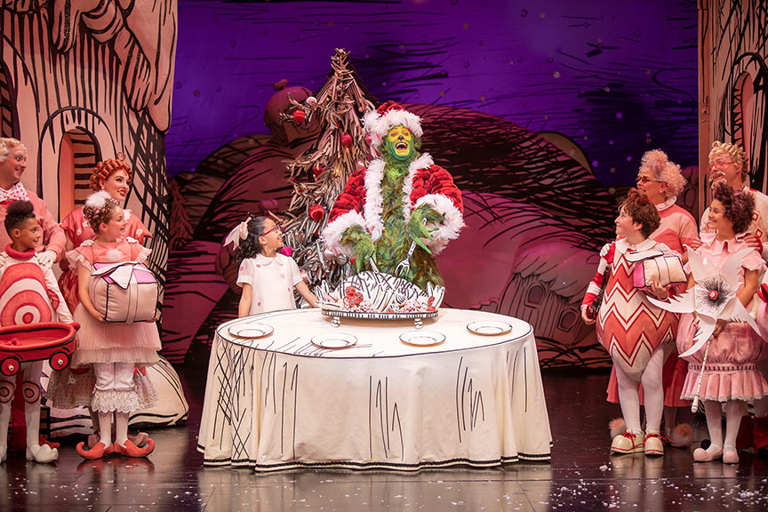 (center) Sophia Adajar as Cindy-Lou Who and Edward Watts as The Grinch with the cast of Dr. Seuss's How the Grinch Stole Christmas!, book and lyrics by Timothy Mason, music by Mel Marvin, original production conceived and directed by Jack O'Brien, original choreography by John DeLuca, and directed by James Vásquez, running November 10 – December 29, 2019 at The Old Globe. Photo by Jim Cox.