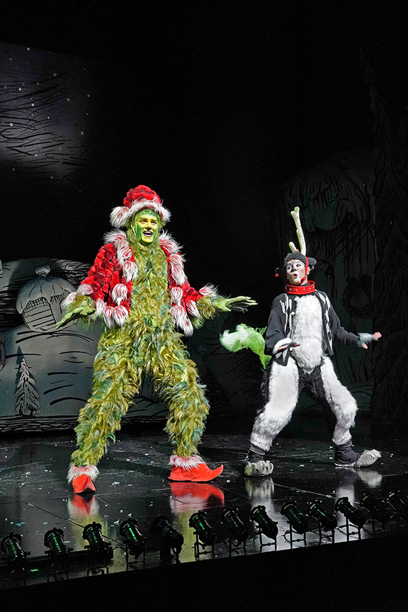 (from left) Edward Watts appears as The Grinch and Tommy Martinez as Young Max in Dr. Seuss's How the Grinch Stole Christmas!, 2018. Book and lyrics by Timothy Mason, music by Mel Marvin, original production conceived and directed by Jack O'Brien, original choreography by John DeLuca, and directed by James Vásquez, running November 10 – December 29, 2019 at The Old Globe. Photo by Ken Howard.
