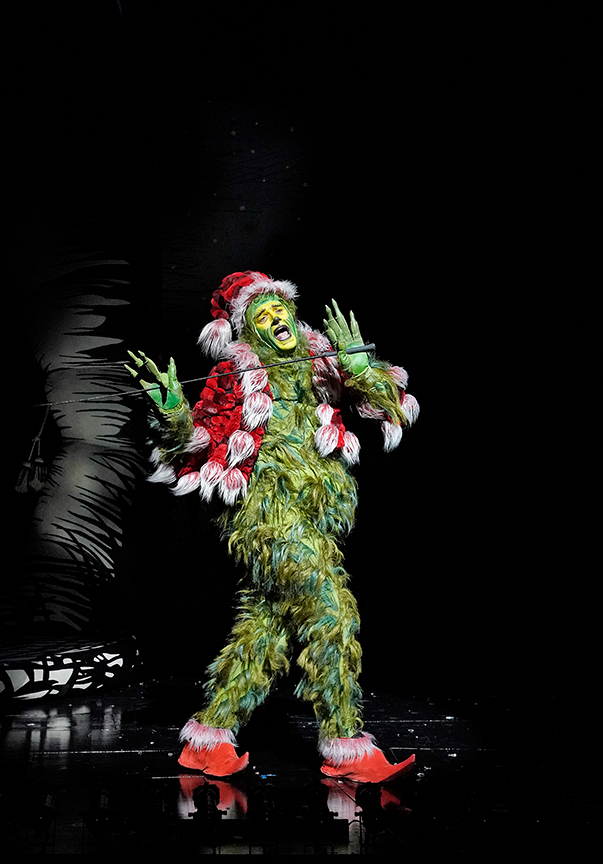 (from left) Edward Watts appears as The Grinch in Dr. Seuss's How the Grinch Stole Christmas!, 2018. Book and lyrics by Timothy Mason, music by Mel Marvin, original production conceived and directed by Jack O'Brien, original choreography by John DeLuca, and directed by James Vásquez, running November 10 – December 29, 2019 at The Old Globe. Photo by Ken Howard.