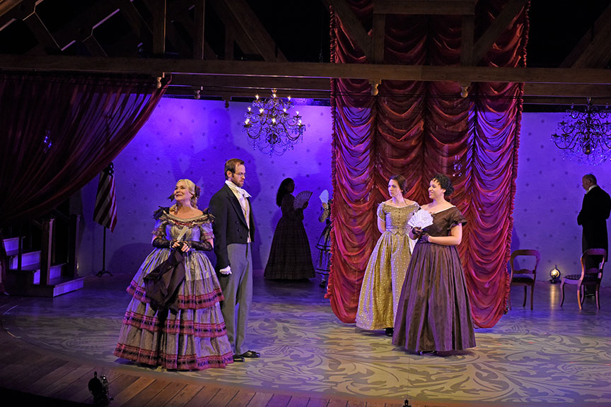 (from left) Sally Nystuen Vahle as Aunt March, Alex Organ as John Brooks, Pearl Rhein as Jo March, and Jennie Greenberry as Meg March. The West Coast premiere of Little Women by Kate Hamill, directed by Sarah Rasmussen, presented in association with Dallas Theater Center, runs March 14 – April 19, 2020 at The Old Globe. Photo by Karen Almond.