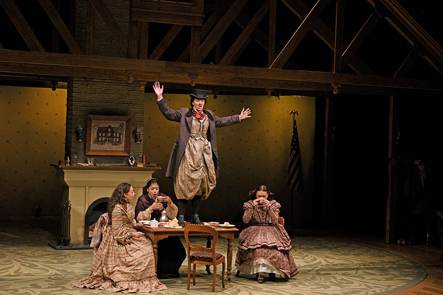 Maggie Thompson as Beth March, Jennie Greenberry as Meg March, Pearl Rhein as Jo March, and Lilli Hokama as Amy March. The West Coast premiere of Little Women by Kate Hamill, directed by Sarah Rasmussen, presented in association with Dallas Theater Center, runs March 14 – April 19, 2020 at The Old Globe. Photo by Karen Almond.