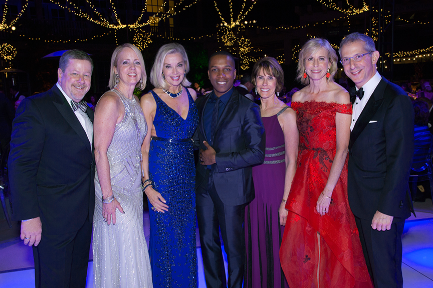 Gala performer and Tony Award winner Leslie Odom, Jr. (center) with (from left) Old Globe Managing Director Michael G. Murphy; Gala Co-Chairs Sheryl White, Karne Cohn, Nina Doede, and Laurie Mitchell; and Old Globe Artistic Director Barry Edelstein at the 2016 Globe Gala - A Night of Revels - on Saturday, September 24, 2016. Photo by Bob Ross.