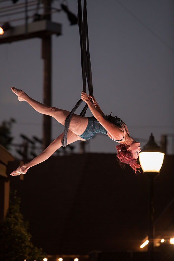 Aerialist on The Old Globe's Copley Plaza. Photo by Melissa Jacobs.