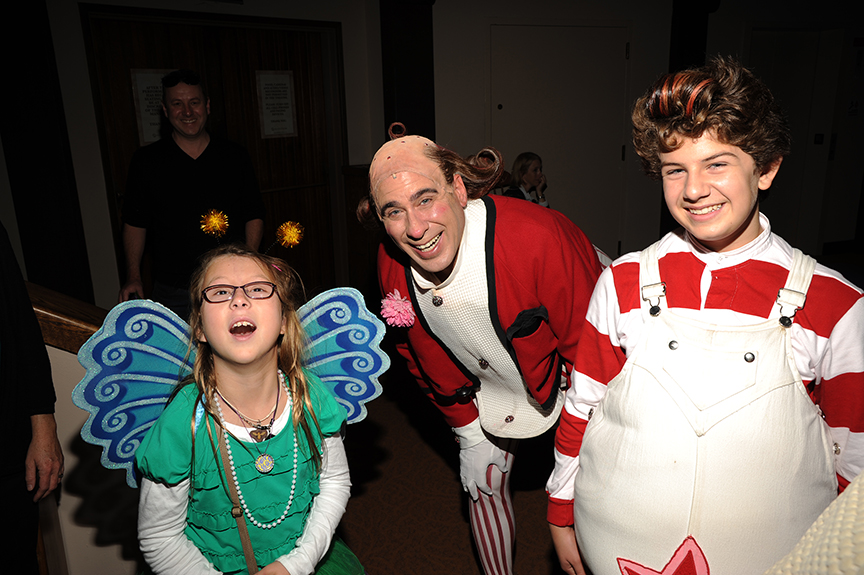 Audience member Daisy Wright and cast members David Kirk Grant and Dylan Nalbandian following the 2014 sensory-friendly performance of Dr. Seuss's How the Grinch Stole Christmas!, book and lyrics by Timothy Mason, music by Mel Marvin, original production conceived and directed by Jack O'Brien, original choreography by John DeLuca, and directed by James Vásquez, at The Old Globe. Photo by Douglas Gates.